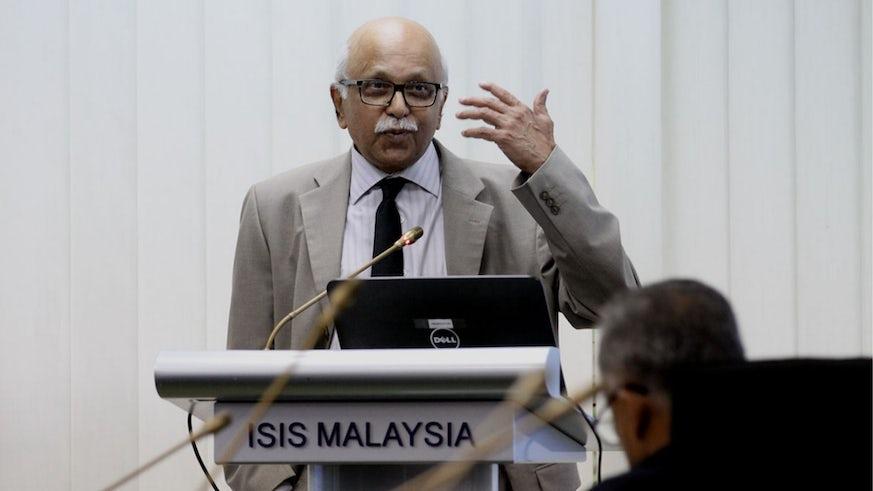Image of Dr Rawindaran Nair standing at a lectern