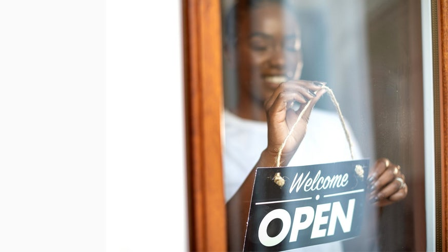 Woman opening shop