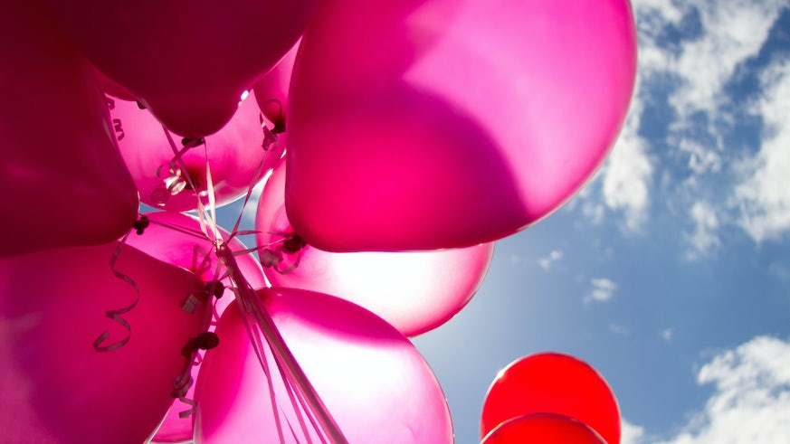 Pink balloons in the sky