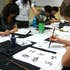Students practice calligraphy