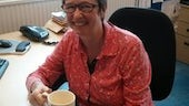 Sally Anstey at desk