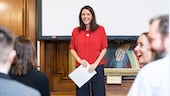 Image of Anni Llŷn, an alumna of the School of Welsh hosting Sabbatical Scheme awards evening