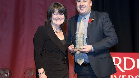 Professor Paul Harper receiving an award