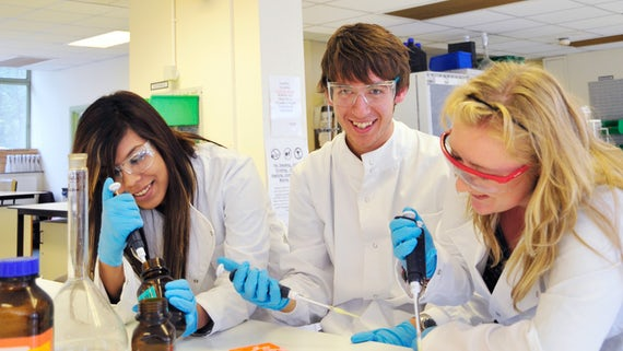 Biosciences male and female students laughing in lab