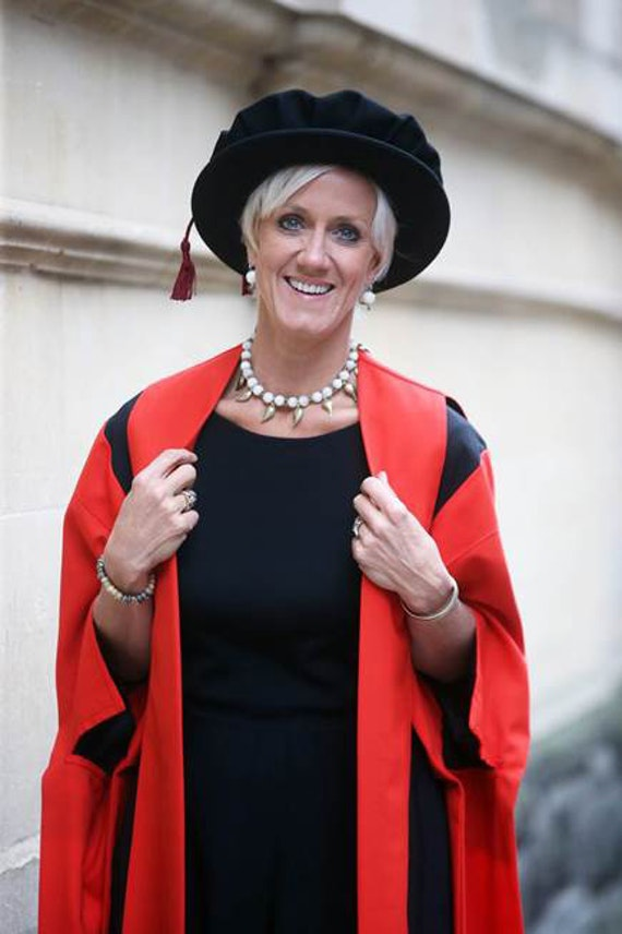 Laura Tenison in graduation robes