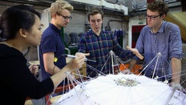 Engineering students work on a model