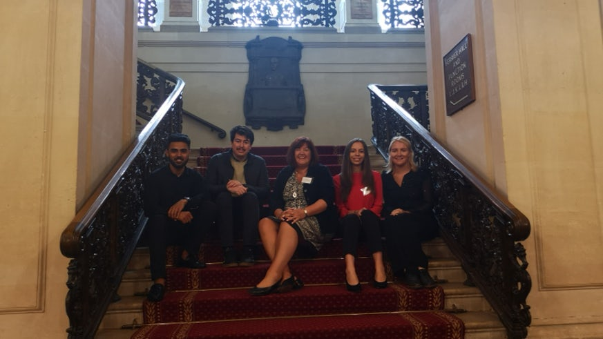 Staff and students sitting on stairway