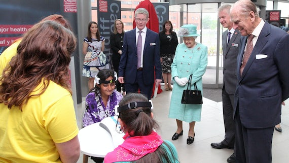 The Queen and Prince Philip watch children taking part in a science experiment