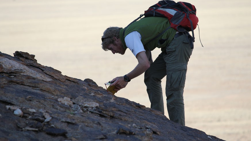 Scientist gathering rock samples in Namibia