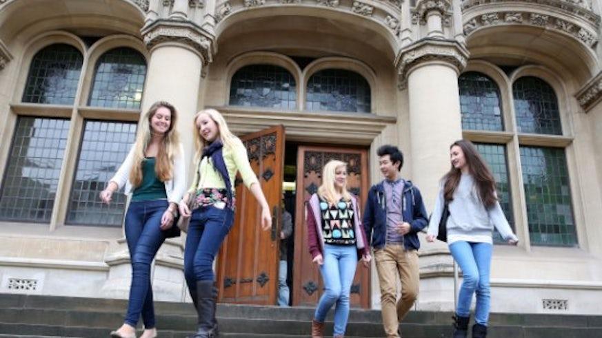 Undergraduate students outside Queen's Buildings