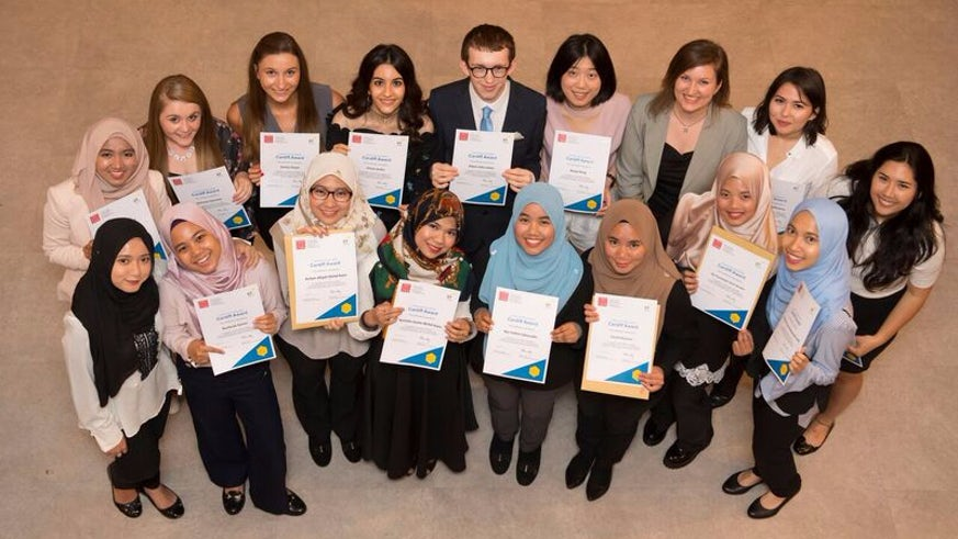 Mixed group of Business School students celebrate their Cardiff Award success