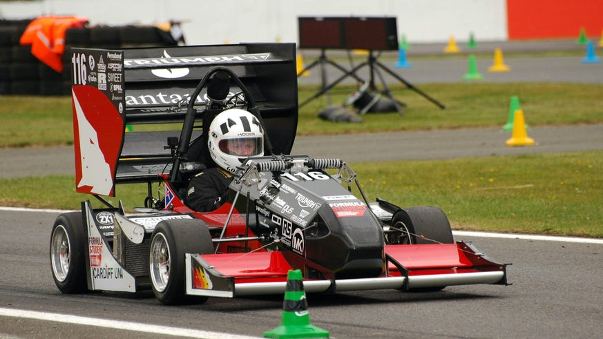 Student driving Formula Student car in race.